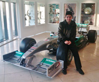 Picture of Kyri with F1 car