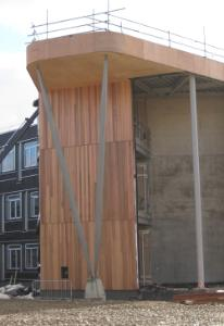 Shows the wooden gable end of the CS building under construction February 2010